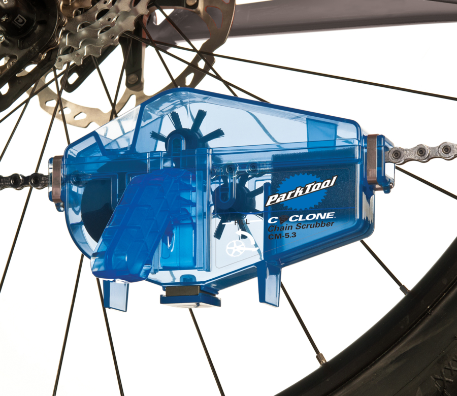 Close-up of Park Tool CM-5.3 Cyclone™ Chain Scrubber installed on bicycle chain, enlarged