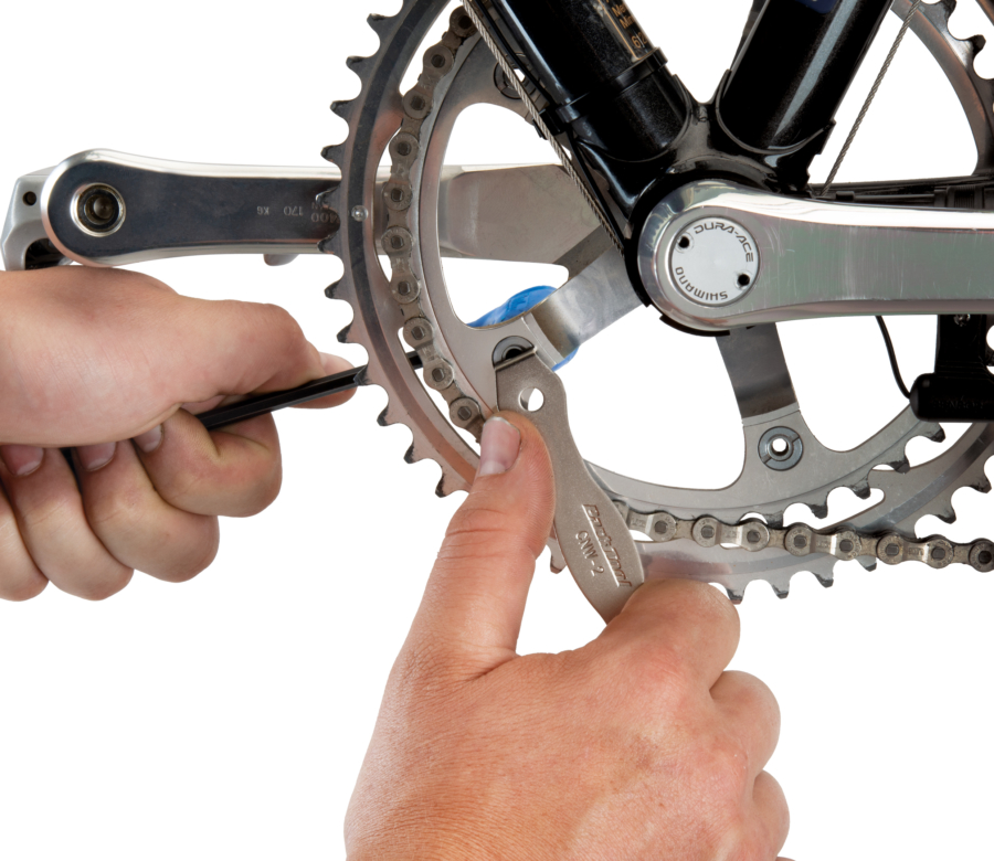 The Park Tool CNW-2 Chainring Nut Wrench engaged on slotted chainring nut, enlarged