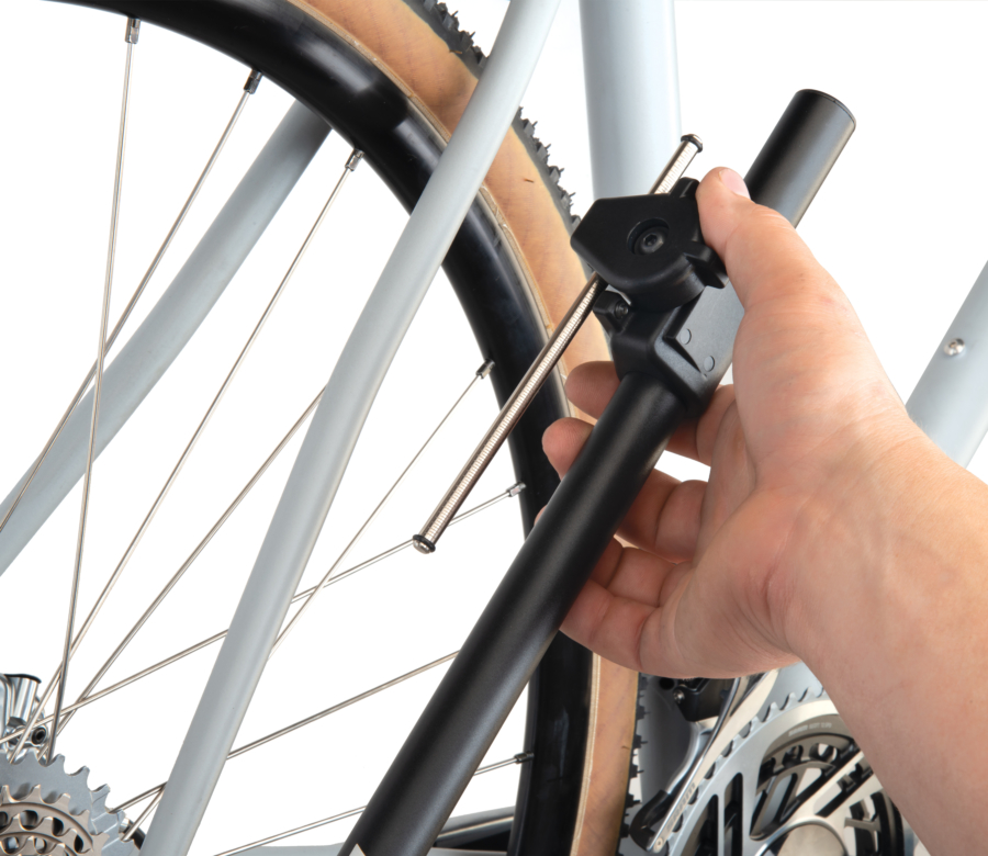 The Park Tool DAG-3 Derailleur Hanger Alignment Gauge sliding indicator pivoting out of the way of seat stay, enlarged