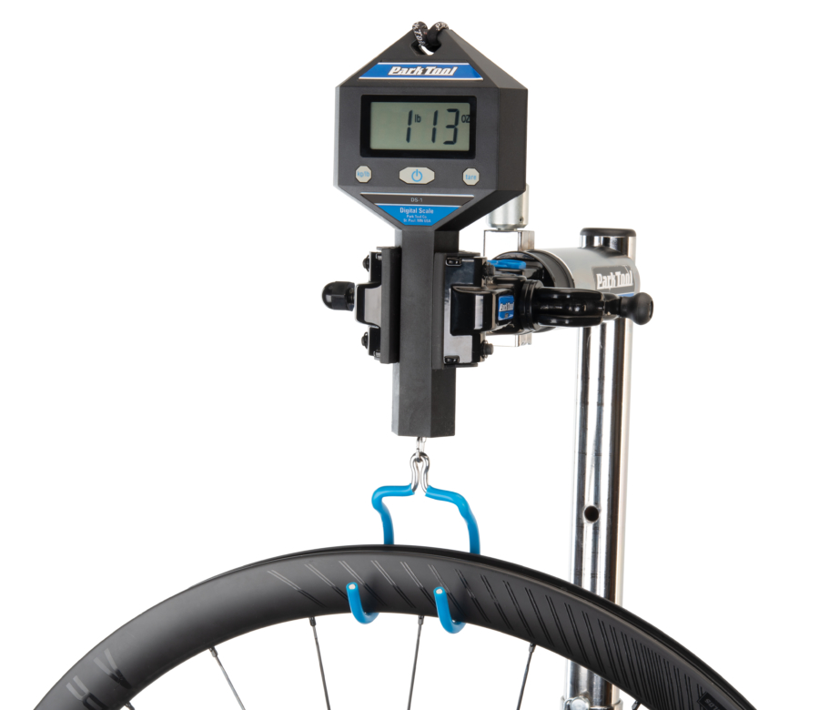 The Park Tool DS-1 Digital Scale weighing a carbon fiber bicycle wheel, enlarged
