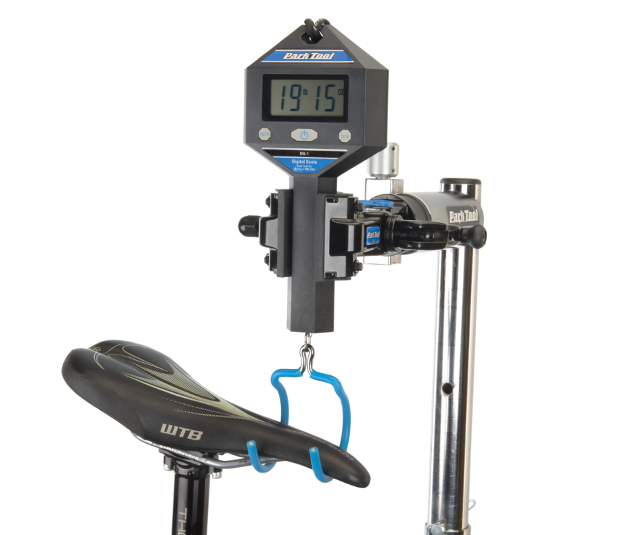 The Park Tool DS-1 Digital Scale weighing a mountain bike by its saddle, enlarged