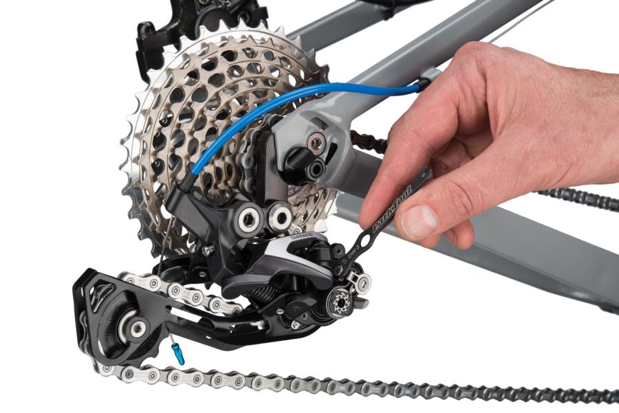 The Park Tool DW-2 Derailleur Clutch Wrench adjusting clutch on Shimano® rear derailleur, enlarged