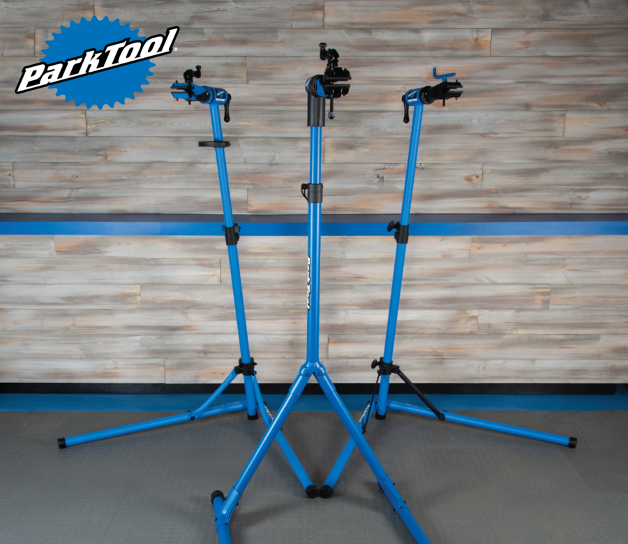 Three Park Tool repair stands and a Park Tool logo in the corner, enlarged