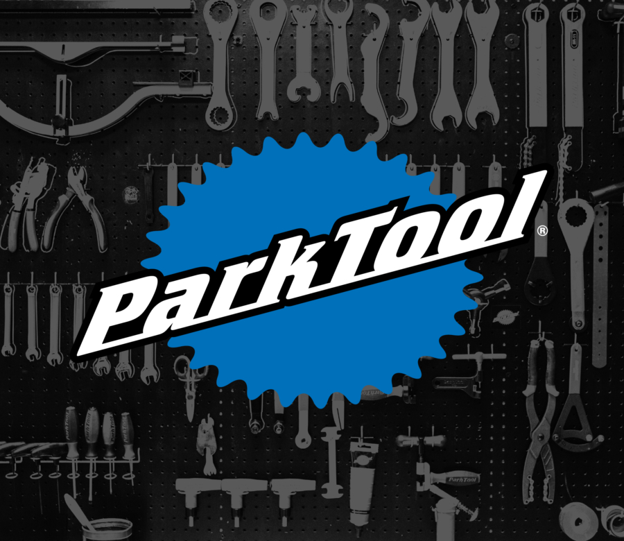 Park Tool logo with black and gray tool pattern behind it, enlarged