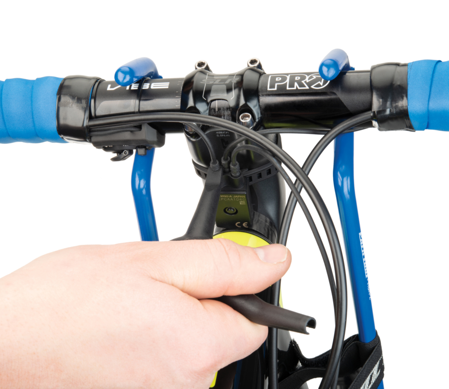The Park Tool Bicycle Electronic Shift Tool removing E-TUBE® from a junction, enlarged
