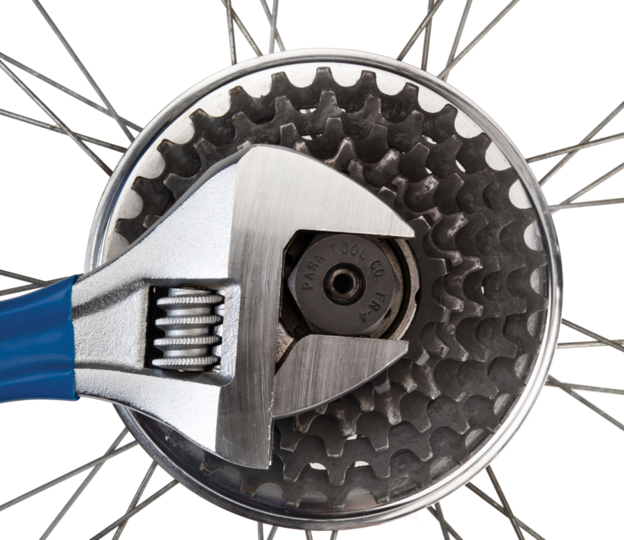 Park Tool FR-4 Freewheel Remover driven by adjustable wrench removing a 20-spline freewheel, enlarged