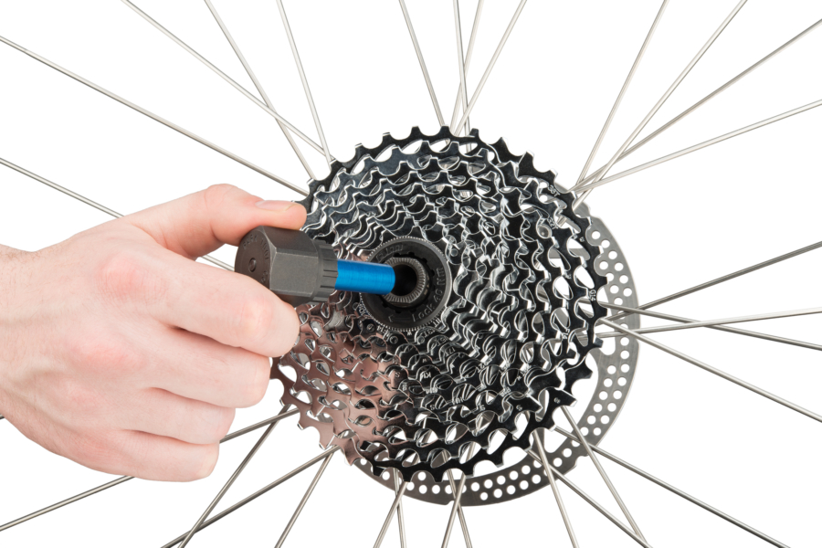 The Park Tool FR-5GT, Cassette Lockring Tool 12mm Guide Pin being installed on SRAM® XD style rear cassett, enlarged