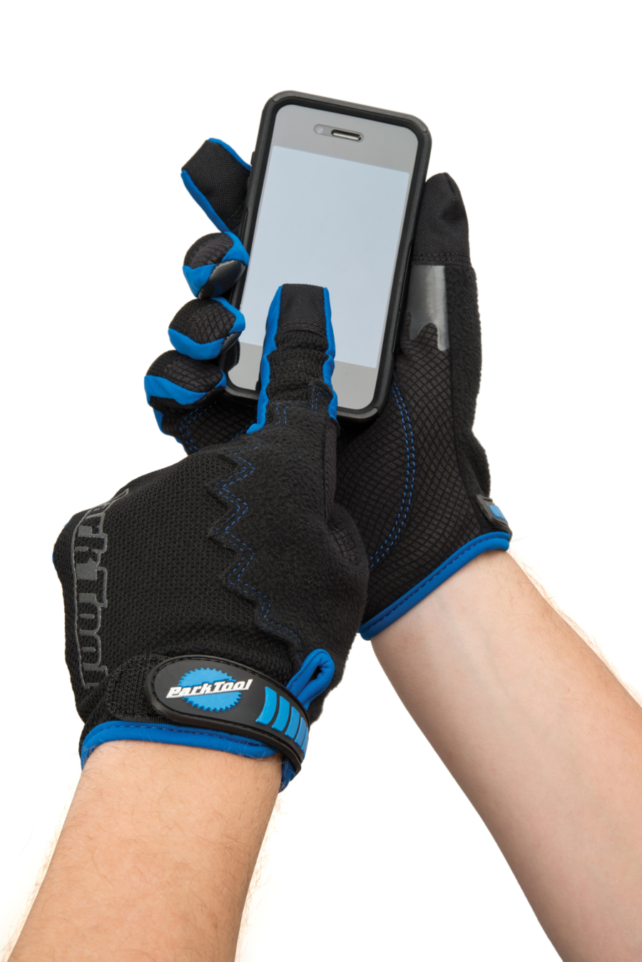The Park Tool GLV-1 Mechanic's Gloves on hands holding smartphone and touching screen, enlarged