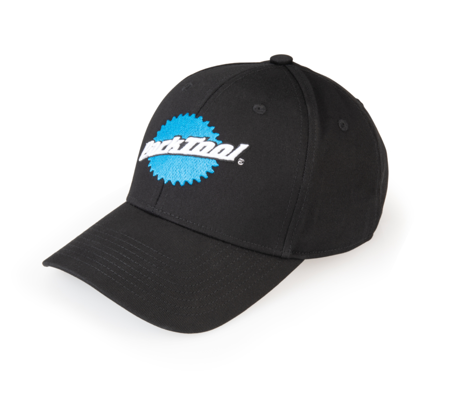 Side view of black baseball hat with stacked Park Tool logo on the front, enlarged