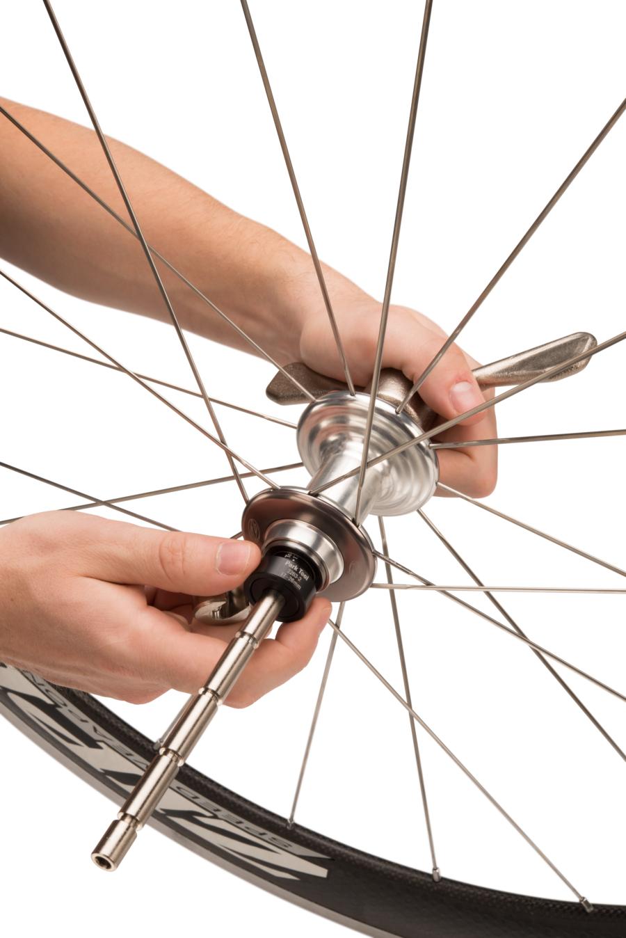 The Park Tool HBP-1 Hub Bearing Press Set installing bearings inside road bike hub, enlarged