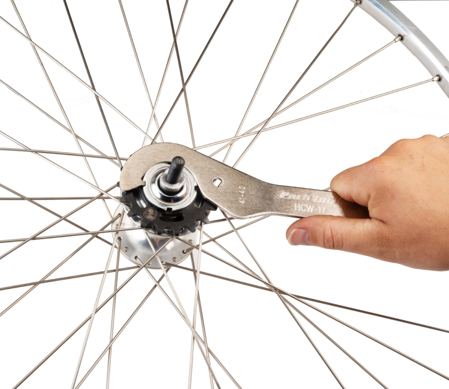 Park Tool HCW-17 Fixed-Gear Lockring Wrench removing a lockring from a fixed-gear hub, enlarged