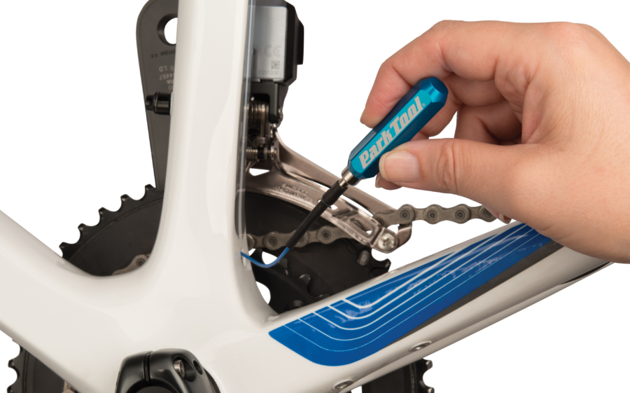 The Park Tool IR-1 Internal Cable Routing Kit magnet pulling through wire, enlarged