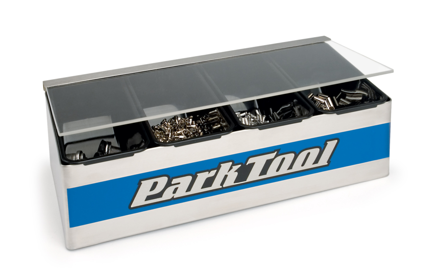 The Park Tool JH-1 Benchtop Small Parts Holder filled with parts, enlarged