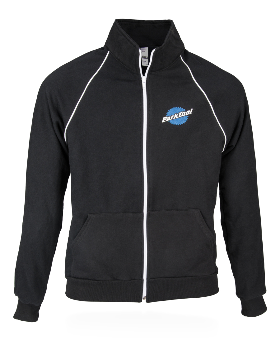 Front view of black Park Tool JKT-1 Mechanic's Track Jacket, featuring embroidered stacked Park Tool logo, enlarged