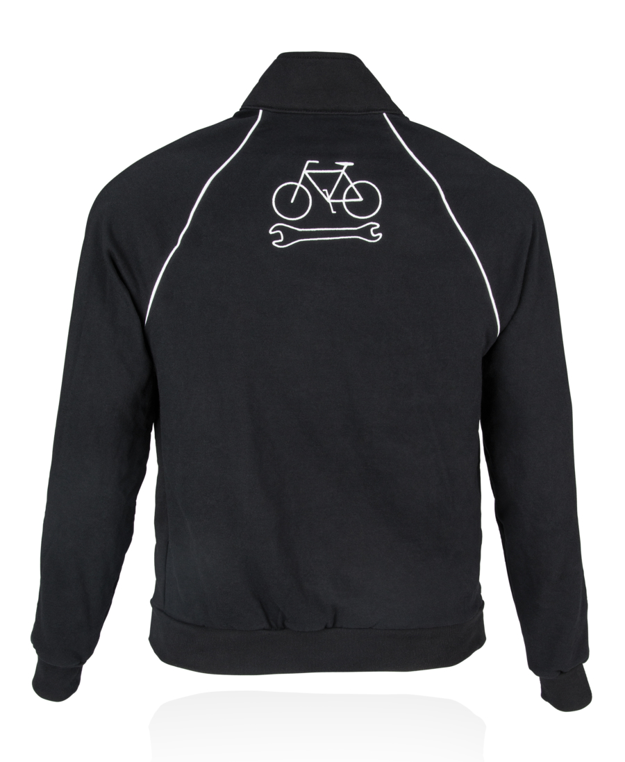Back view of black Park Tool JKT-1 Mechanic's Track Jacket, featuring embroidered bike wrench icon, enlarged