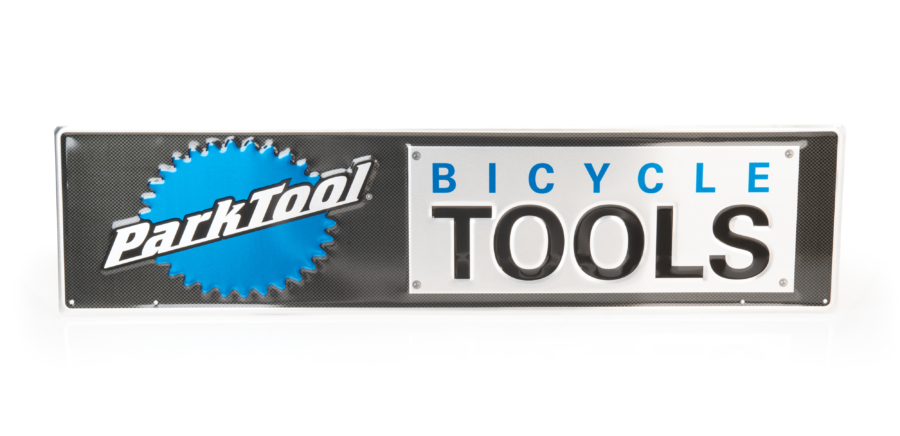 Metal bicycle tools sign with Park Tool logo on the left side, enlarged