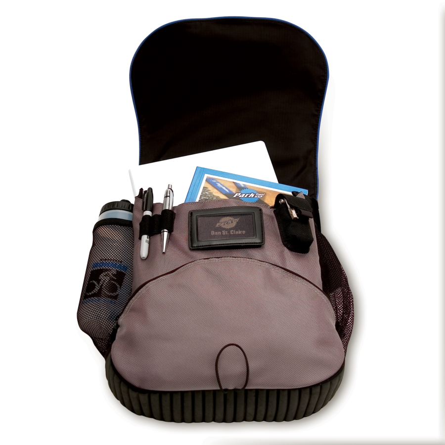 Opened MP-1 Messenger Bag, with laptop, book, water bottle, and pens secured in the bag, enlarged