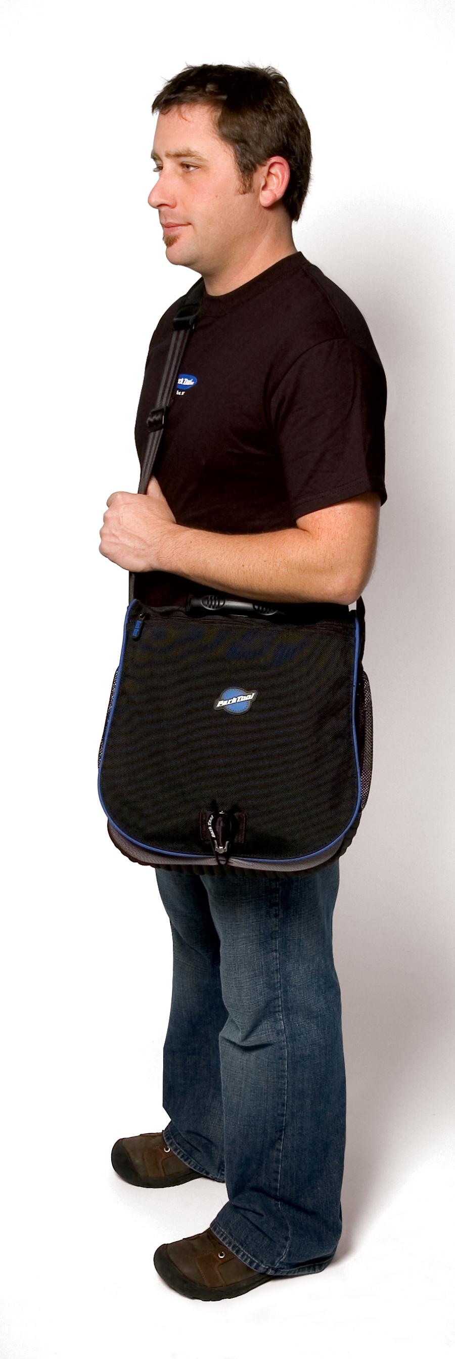 Male model with MP-1 Messenger Bag slung over shoulder, enlarged
