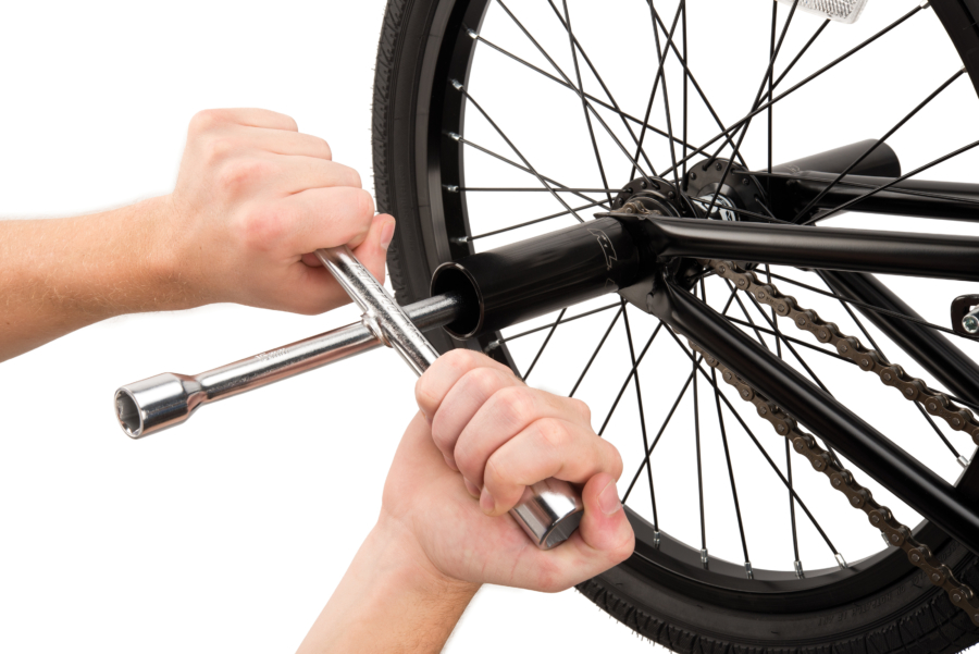 The Park Tool MQ-1, Metric Quad Wrench removing axel nuts from BMX bike with pegs, enlarged