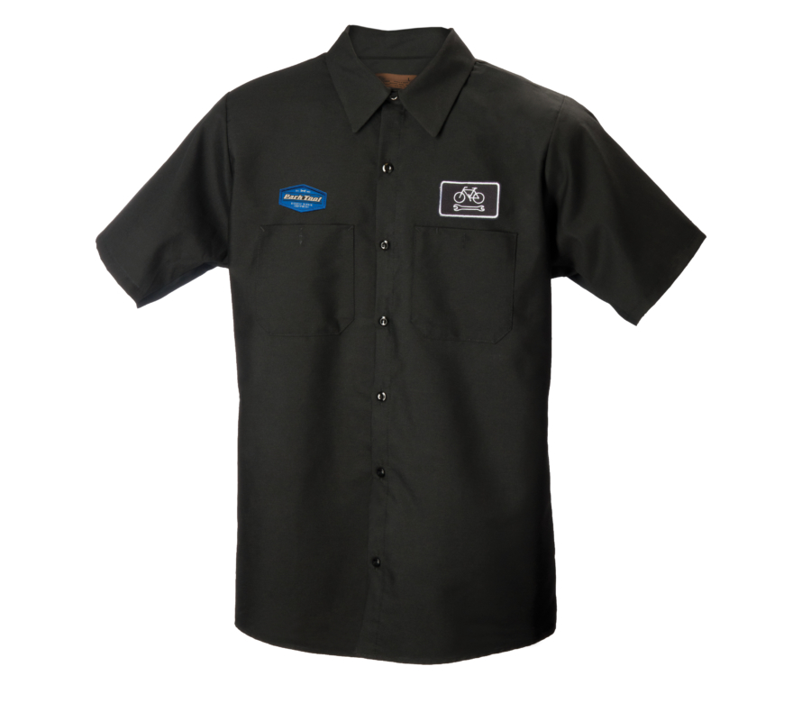 Black collared button up mechanics with two different Park Tool logos on each chest, enlarged