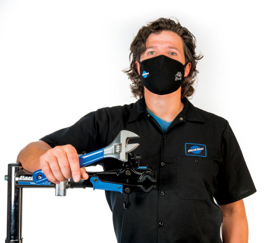 Park Tool Tech Guru Truman wearing the MSK-1 Face Mask while leaning against a Shop Repair Stand, enlarged