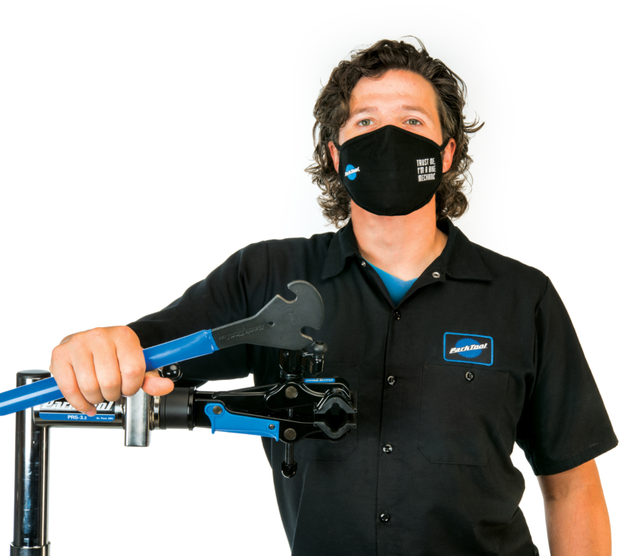 Park Tool Tech Guru Truman wearing the MSK-2 Face Mask while leaning against a Shop Repair Stand, enlarged