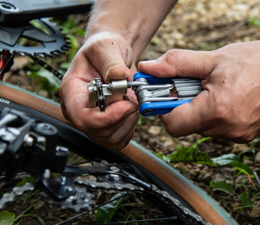 The Park Tool MTB-5 Rescue Tool being used to break a chain on a mountain bike, enlarged