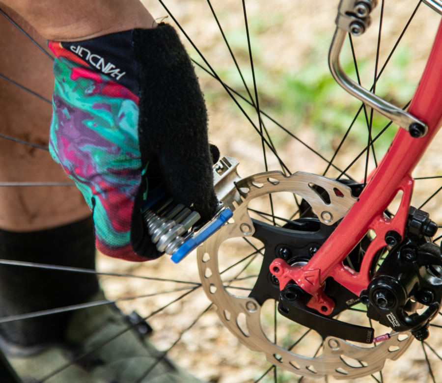 The Park Tool MTB-5 Rescue Tool being used to straighten a mountain bike disc brake rotor, enlarged