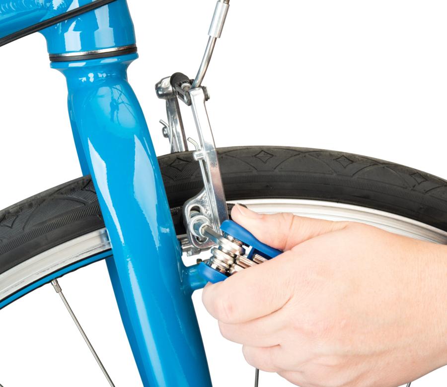 The Park Tool MTC-25 Multi-Tool adjusting angle on V-brake pad, enlarged