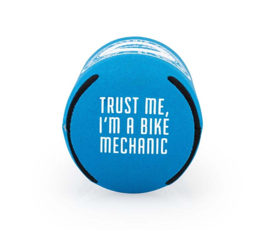 "Bottom of the Park Tool can cooler saying ""Trust me I'm a bike mechanic"", enlarged"