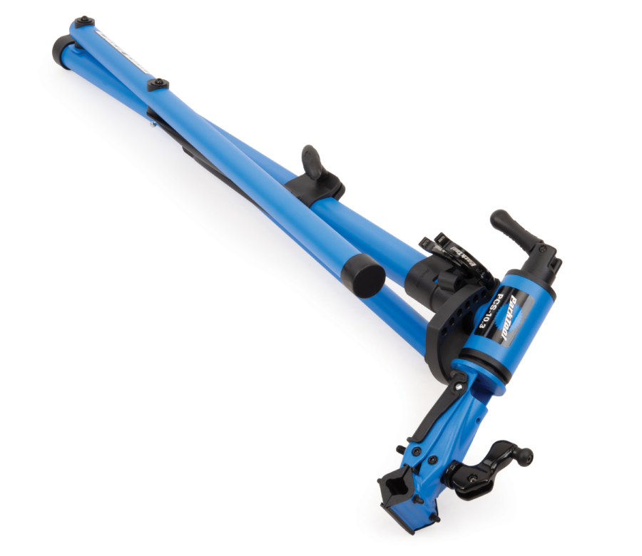 The Park Tool PCS-10.3 Deluxe Home Mechanic Repair Stand folded down for transport and storage, enlarged