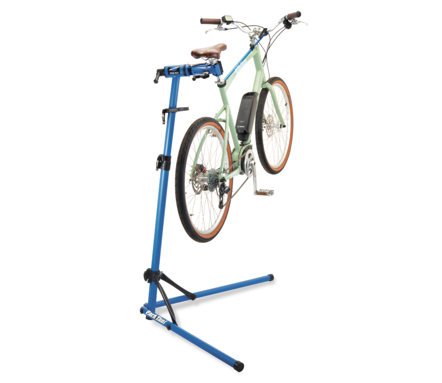 The Park Tool PCS-10.3 Deluxe Home Mechanic Repair Stand holding an e-bike, enlarged