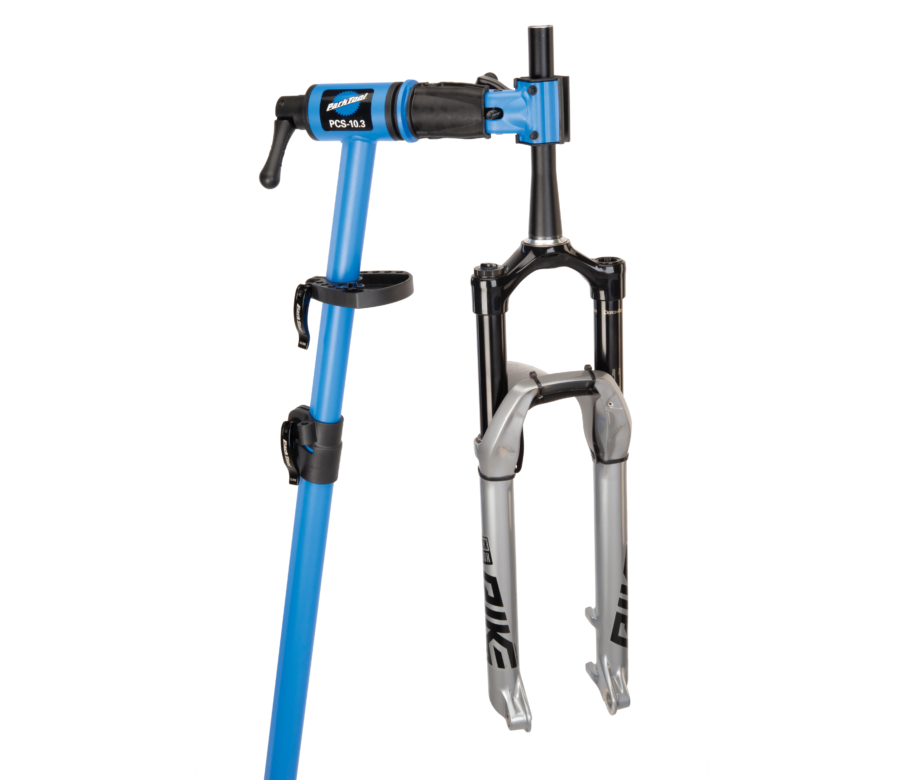 The Park Tool PCS-10.3 Deluxe Home Mechanic Repair Stand holding a MTB suspension fork, enlarged