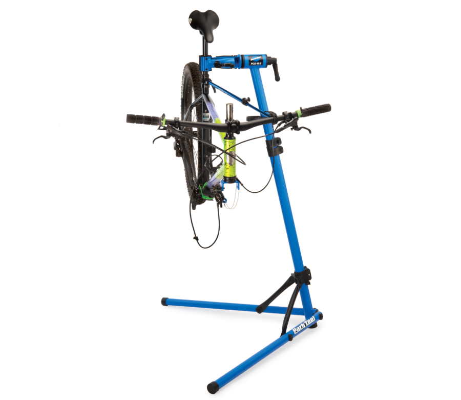 The Park Tool PCS-10.3 Deluxe Home Mechanic Repair Stand holding a MTB with fork removed, enlarged