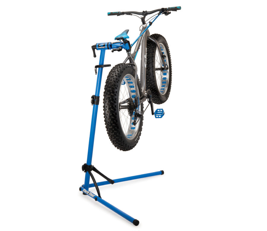The Park Tool PCS-10.3 Deluxe Home Mechanic Repair Stand holding a fat bike, enlarged