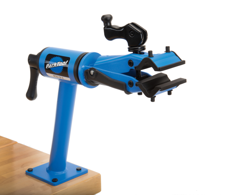 Park Tool PCS-12.2 Home Mechanic Bench Mount Repair Stand mounted to a maple workbench, enlarged