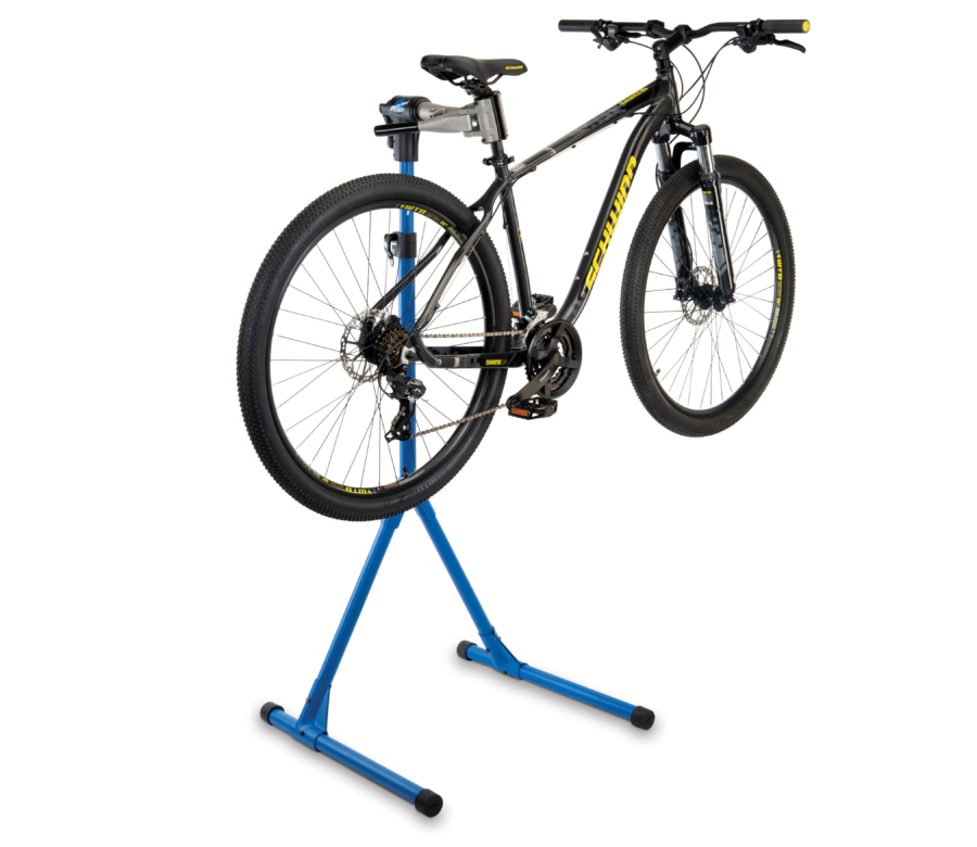 The Park Tool PCS-4-1 Deluxe Home Mechanic Repair Stand with a mountain bike clamped on the seat post, enlarged