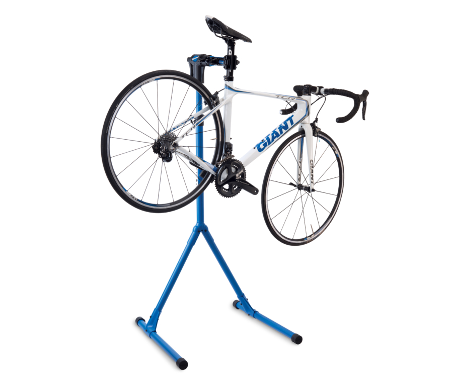 The Park Tool PCS-4-2 Deluxe Home Mechanic Repair Stand with a road bike clamped on the seat post, enlarged