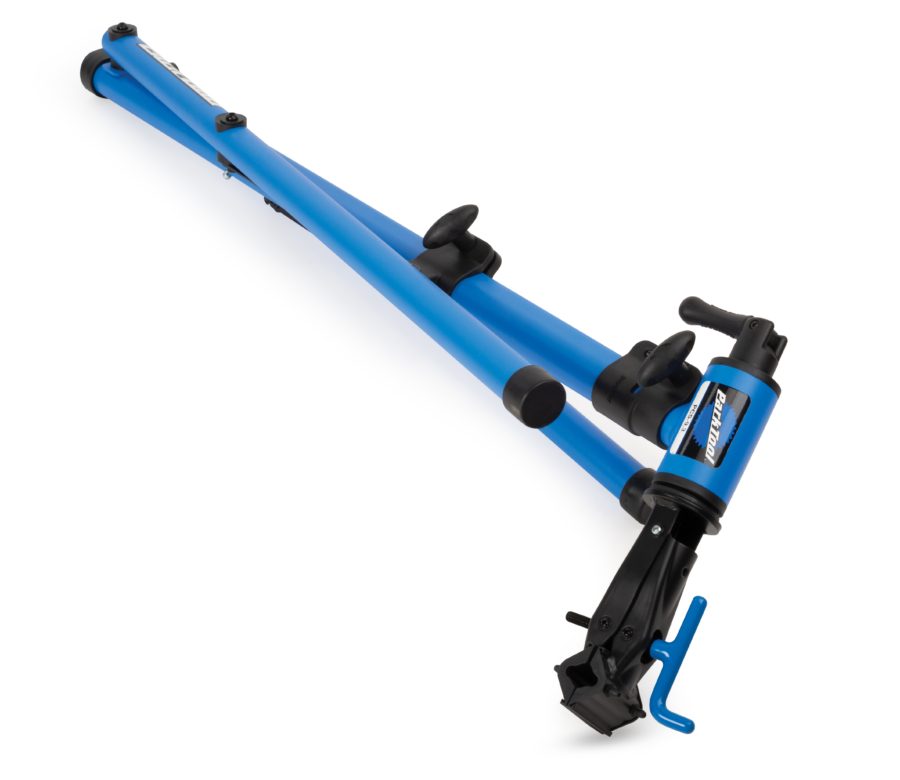 The Park Tool PCS-9.3 Home Mechanic Repair Stand folded down for transport and storage, enlarged
