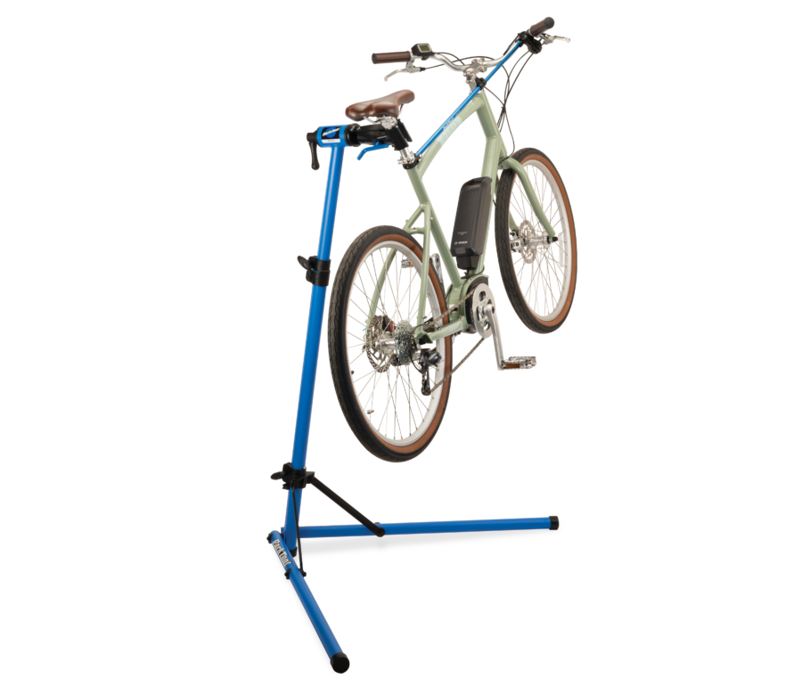 The Park Tool PCS-9.3 Home Mechanic Repair Stand holding an e-bike, enlarged