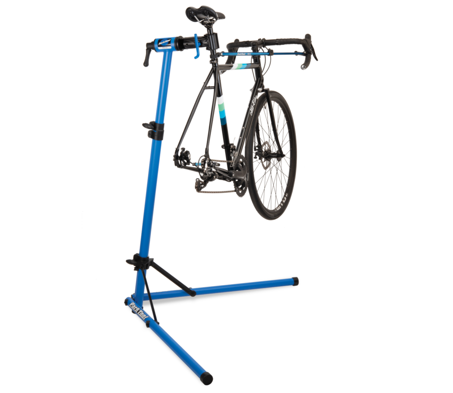 The Park Tool PCS-9.3 Home Mechanic Repair Stand holding a road bike with rear wheel removed, enlarged