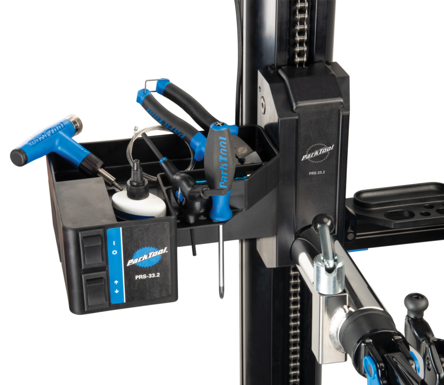 Close-up of tools in the Park Tool PRS-33.2 Power Lift Shop Stand tool tray and power lift, enlarged