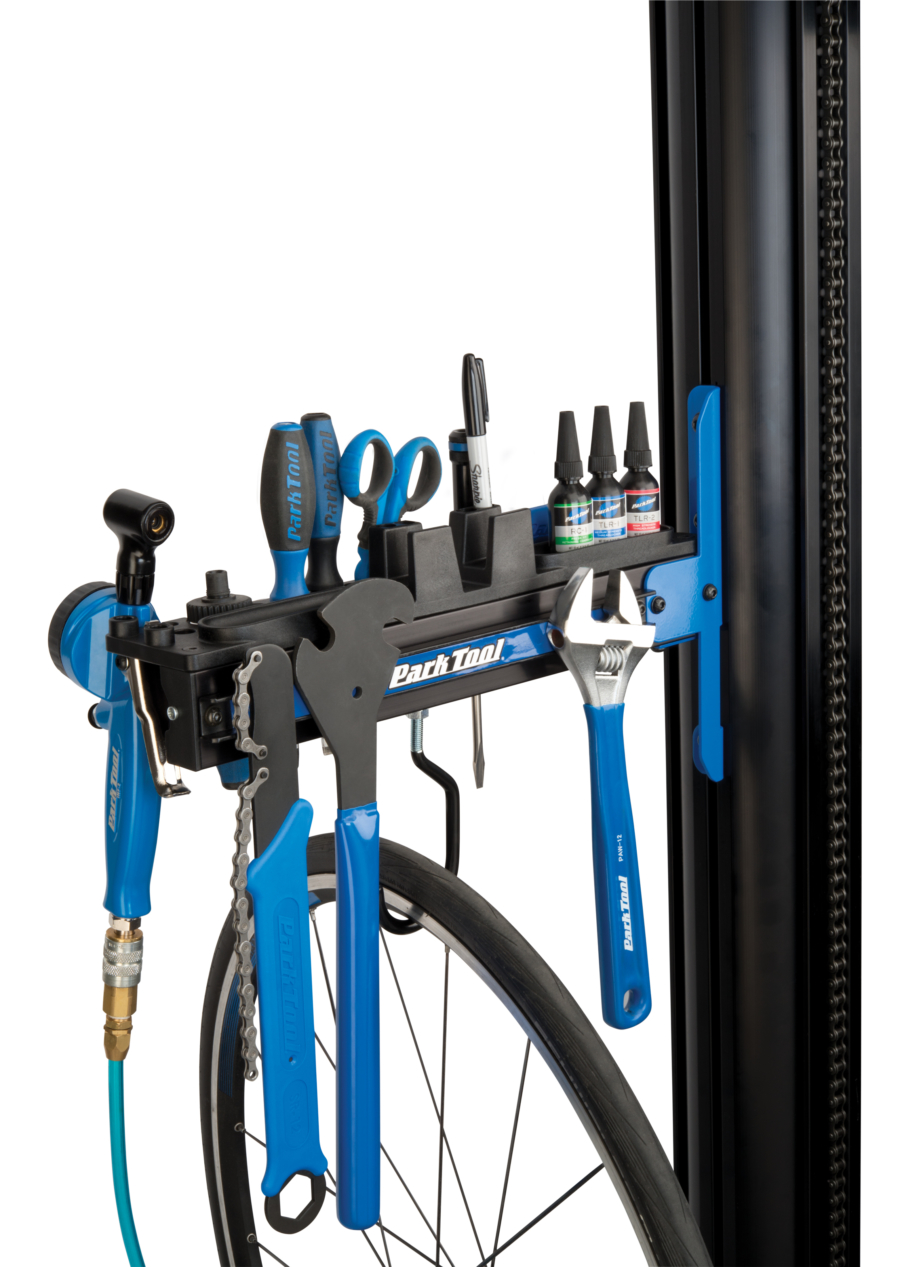Park Tool PRS-33TT Deluxe Tool and Work Tray attached to repair stand with tools in tray and wheel on hook, enlarged