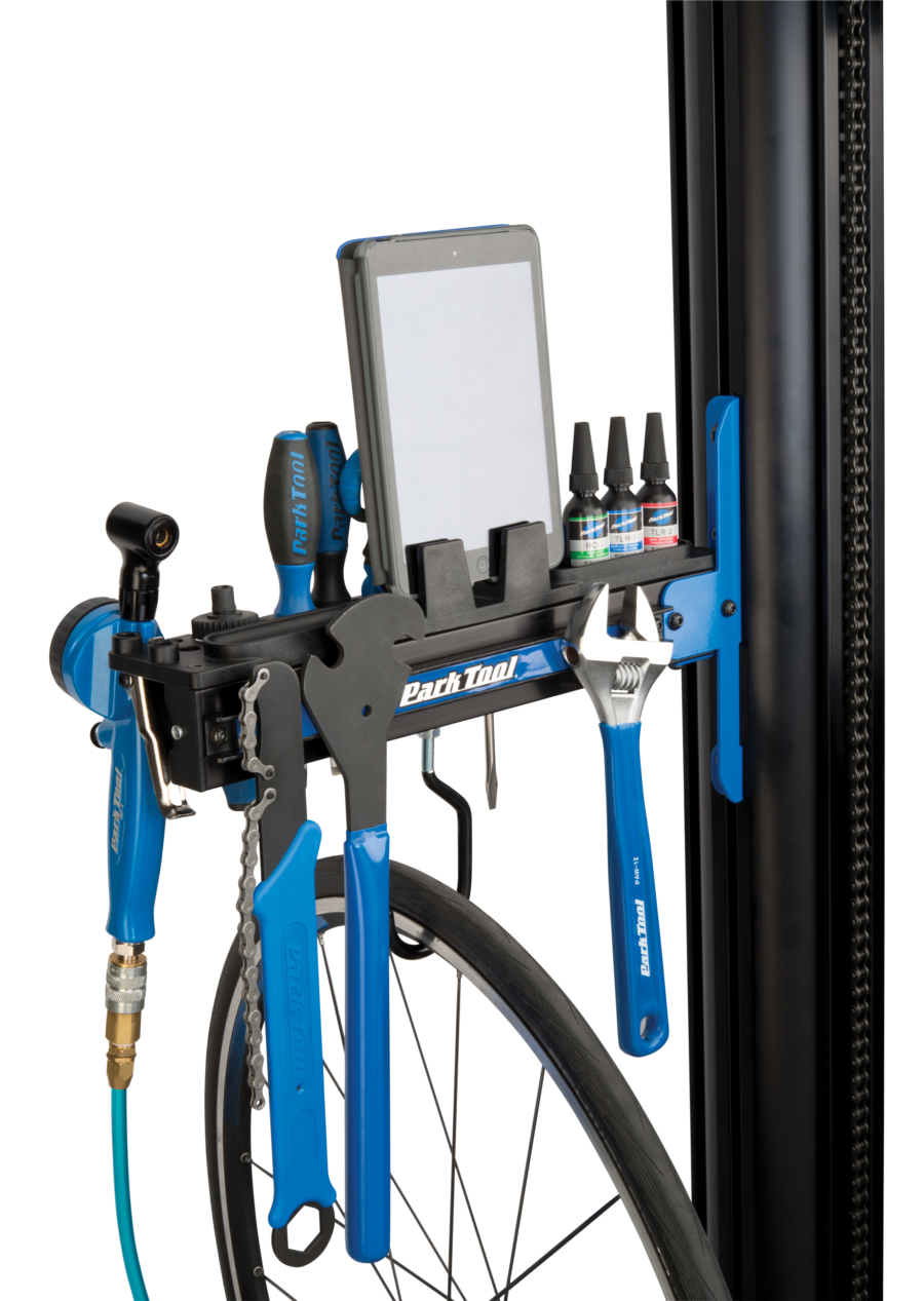 The Park Tool PRS-33TT Deluxe Tool and Work Tray full of tools and an iPad® attached to repair stand, enlarged