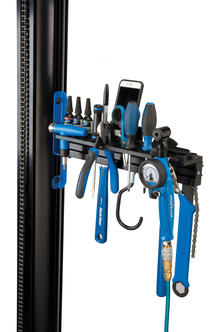The Park Tool PRS-33TT Deluxe Tool and Work Tray full of tools and a phone attached to repair stand, enlarged