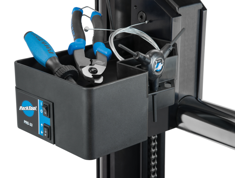 The Park Tool PRS-33 Power Lift Stand tool compartment with tools placed on it, enlarged