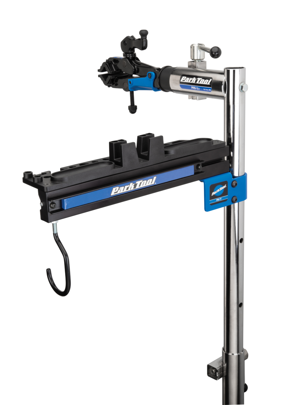 An empty Park Tool PRS-TT Deluxe Tool and Work Tray on top of a single arm Park Tool repair stand, enlarged