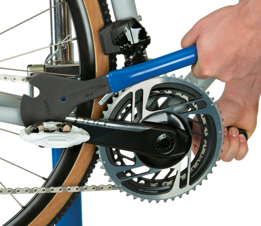 The Park Tool PW-4 Professional Pedal Wrench removing a road bike pedal, enlarged