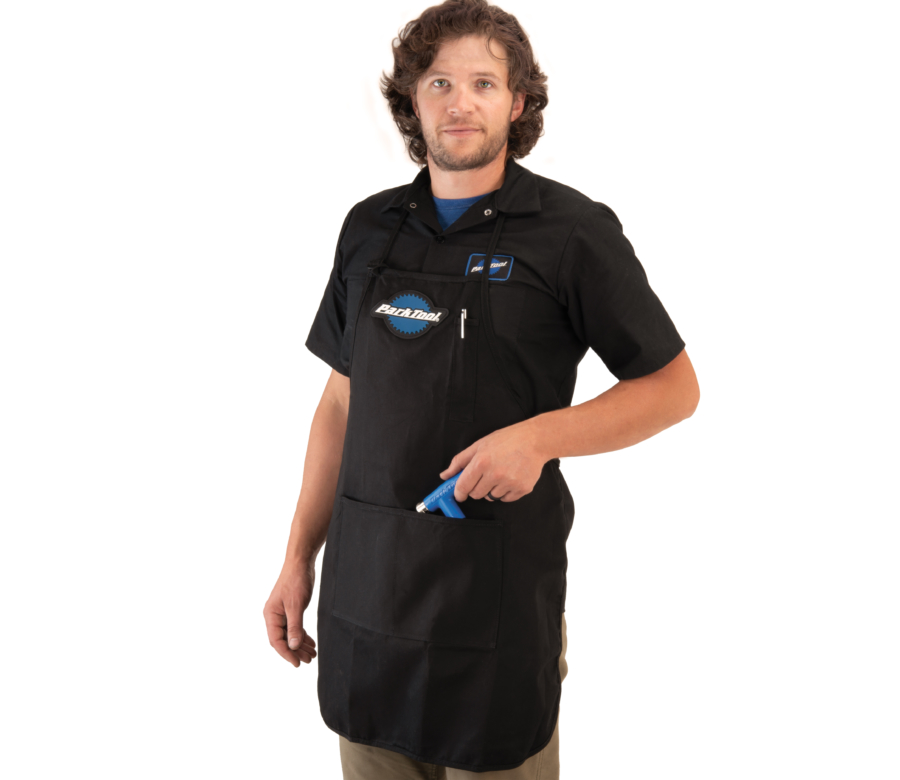 Model wearing the Park Tool SA-1 Shop Apron, enlarged