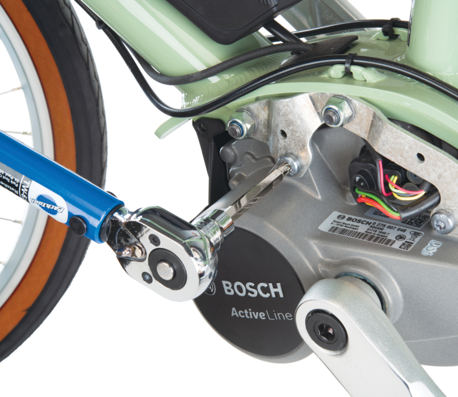 Long reach T30 bit from the SBS securing motor mounting bolt on green e-bike using TW-6.2 Torque Wrench, enlarged